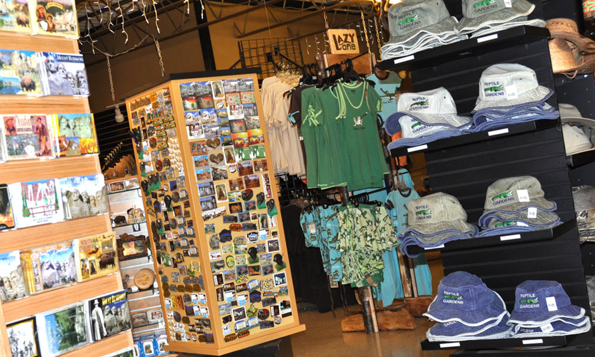 Image of the Reptile Gardens Gift Shop, showcasing magnets, post cards, hats, and apparel.
