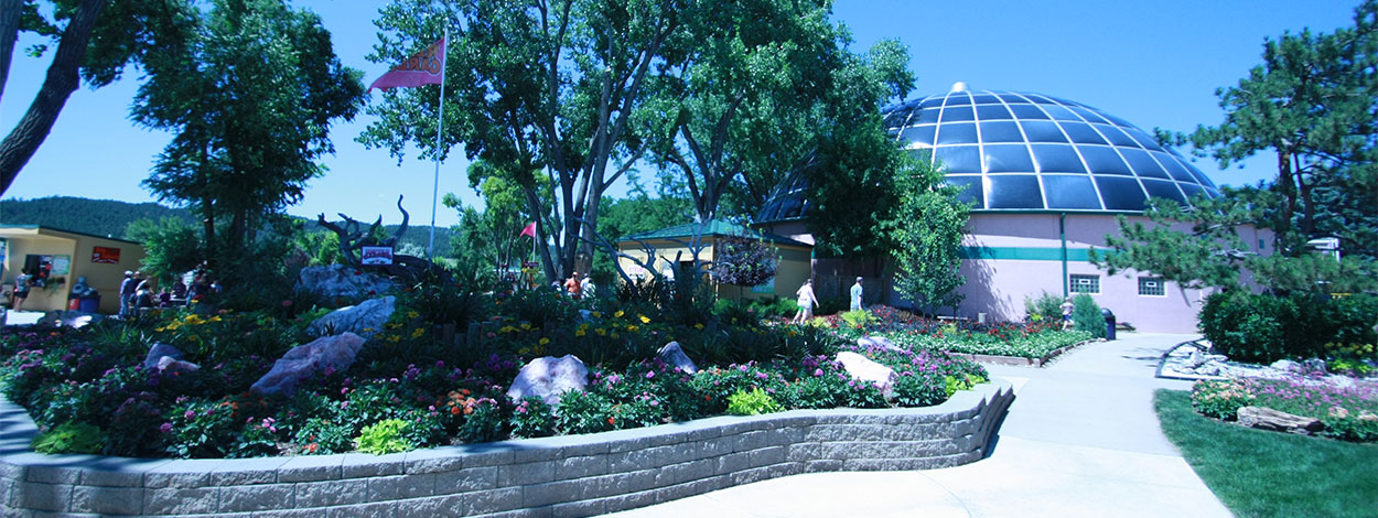 Image of beautiful gardens surrounding sidewalks leading up to the Sky Dome.
